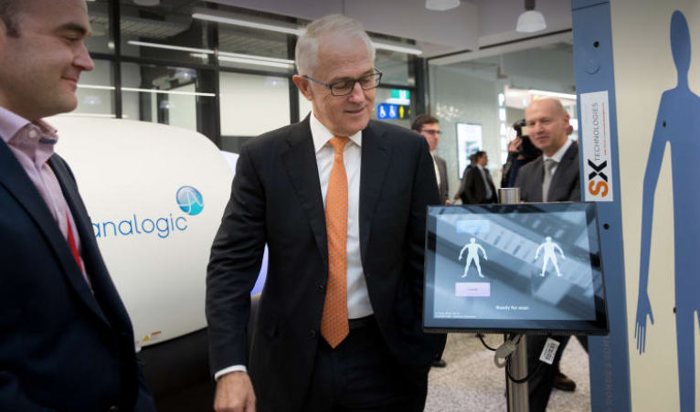 Neuranext's Chief Technology Officer and Co-Founder Daniel Kind discusses advanced screening technologies with Australia's Prime Minister, Malcolm Turnbull.